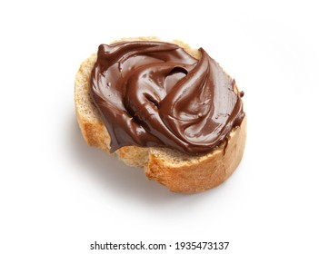 toasted bread slice with chocolate hazelnut cream isolated on white background, top view
