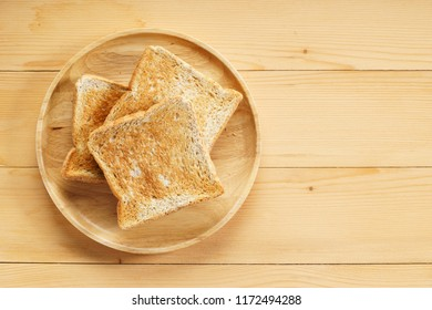 toasted bread slices on wooden table
