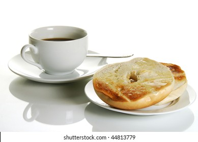 Toasted buttered bagel with a cup of black coffee