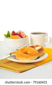 Toasted cheese bagel served with fresh fruit and coffee.