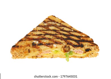 Toasted cheese, ham and spring onion snadwich isolated against white