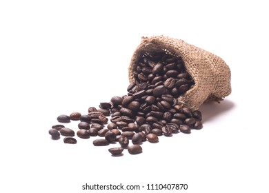 toasted coffee beans with juta bag on a white backgroud
