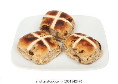 Toasted hot cross buns on a plate isolated against white
