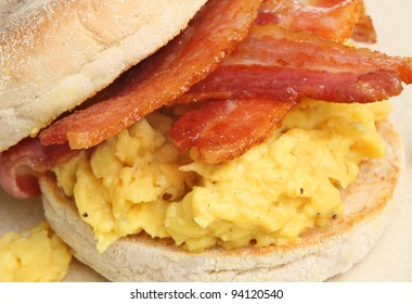 Toasted muffin with bacon and scrambled egg