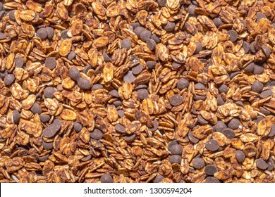 Toasted oatmeal granola or muesli texture background. Homemade organic granola cereal with chocolate.