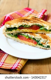 Toasted sandwich with cheese, tomato and salad