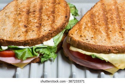 Toasted Sandwich with lettuce, tomato, ham and cheese
