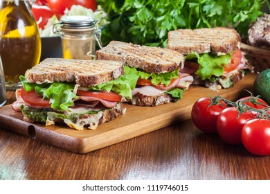 Toasted sandwiches with ham, cheese, tomatoes, lettuce and cucumber. Fresh delicious dish