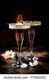 Toasted smores martini with chocolate liquor, cream, marshmallow and graham cracker rim