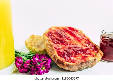 Toasted sourdough english muffin with strawberry jam and peanut butter