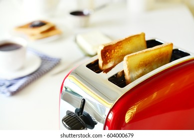 Toaster with bread in kitchen interior closeup