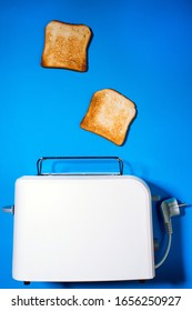 Toaster with slices of bread on a blue background. top view vertical photo. Flat lay