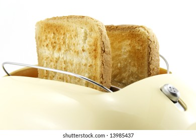 toaster with toast isolated on white background