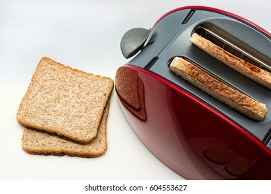 Toaster  with toasted  bread close up top view isolated on white background, Kitchen equipment