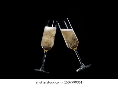 toasting with champagne glasses isolated on black background