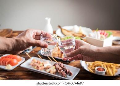 toasting with japanese sake and izakaya popular plates