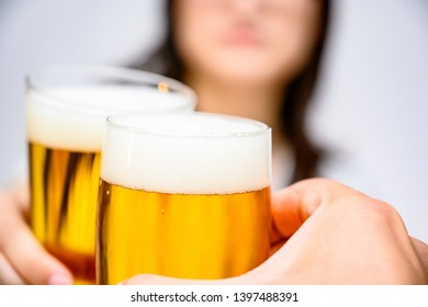 Toasting with a Japanese woman holding a glass of beer