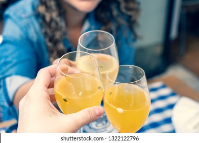 Toasting with passionfruit sangria cocktails at brunch