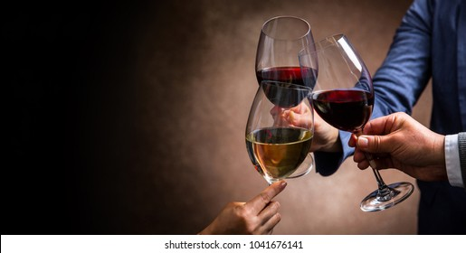 toasting with wine glasses