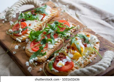 toasts with egg, aragula, tomato and cheese,French toast bread with veggies,Spring healthy toast, healthy breakfast, italian cuisine