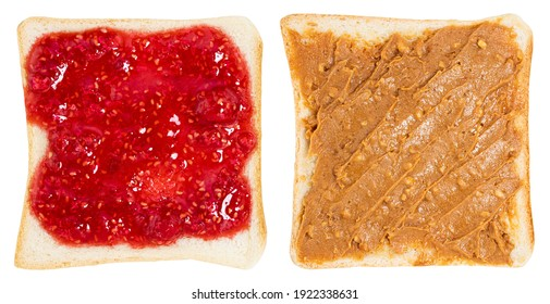 Toasts with peanut butter and berry jam isolated on white background. With clipping path.