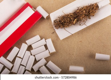 Tobacco and accessories for hand-rolling of cigarette.