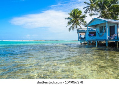 Tobacco Caye - Relaxing at Cabin or bungalow on small tropical island at Barrier Reef with paradise beach, Caribbean Sea, Belize, Central America