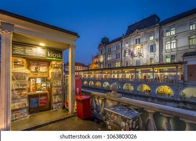 Tobacco kiosk at river side in Plaza PrÄ?sernov at dusk, Ljubljana, Slovenia, Europe 12-12-2017