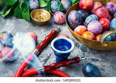 Tobacco shisha with plum flavor.Nargile with plum.Turkish fruit hookah tobacco