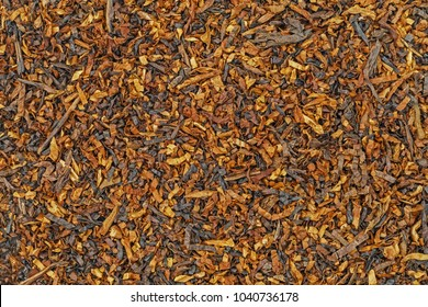 Tobacco texture. High quality dry cut tobacco big leaf, macro close up. Tobacco texture dry cut leaf, close up, background