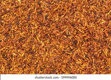 Tobacco texture. High quality dry cut tobacco big leaf, close up, background