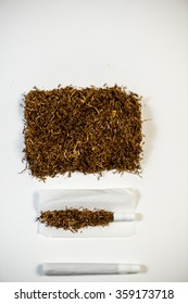 Tobacco and white filter in rolling paper