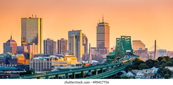Tobin bridge, Zakim bridge and Boston skyline panorama at sunset.