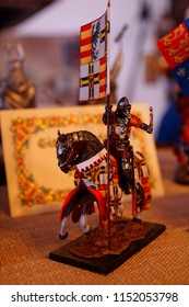 TOBLACH, ITALY - AUG 1, 2018 - Miniatures of mounted medieval crusader knights in a shop in Toblach, Italy
