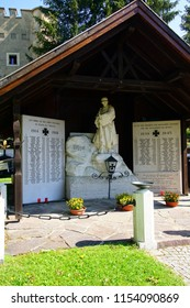 TOBLACH, ITALY - AUG 1, 2018 - Memorial of those who died in the World Wars in the village church cemetery of Toblach, Italy