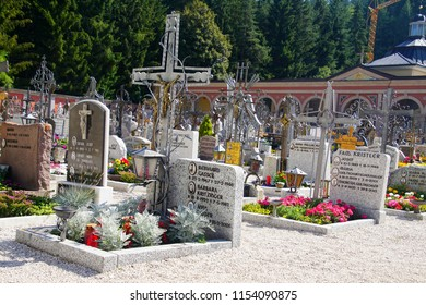 TOBLACH, ITALY - AUG 1, 2018 - Tombstones in the village church cemetery of Toblach, Italy