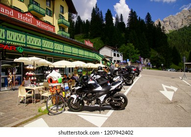 TOBLACH, ITALY - AUG 3, 2018 - Motorcycles parked in front of a restaurant  on Lake Misurina near Toblach, Italy