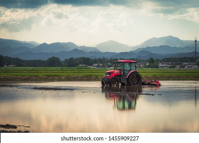 Tochigi, Japan. June 11, 2017. Tractor preparing a rice paddy for planting.