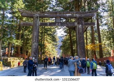 TOCHIGI, JAPAN - NOVEMBER 15, 2018: Day scene of Ishidorii, Stone Torii Gate in Toshogu Shrine  at Nikko, Tochigi Prefecture, Japan