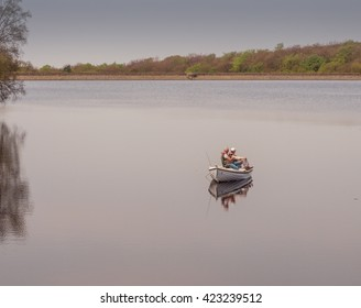 Tockholes, Lancashire, UK. May 6th 2016. Fishermen enjoying some quiet time in a boat on Roddlesworth Reservoir, Tockholes, Lancashire, UK