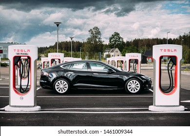 Tocksfors, Sweden- June 26, 2019: Black Color Tesla Model S 100d Car Parked At Charging Station. The Tesla Model S Is A Full-sized All-electric Five-door, Luxury Liftback, Produced By Tesla Inc.