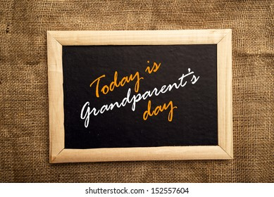 Today is grandparent's day message on black board.
