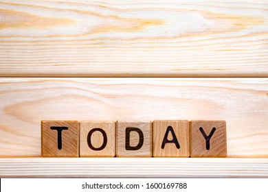 Today word made of wood background. Business concept. Today sign, current day concept. Calendar concept. Word today written with wooden cubes