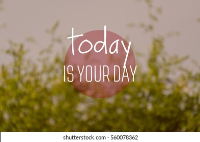 """""""Today is your day"""" text on blurry green nature background. Positive message."""
