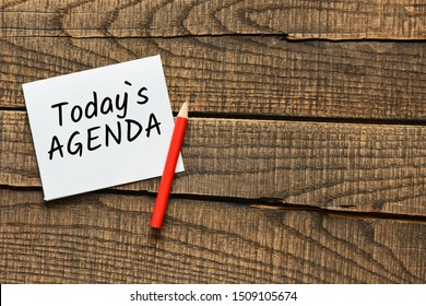 Today`s agenda text on wooden background