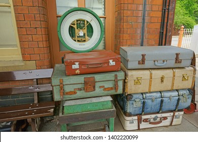 Toddington, Gloucestershire, UK, May 19th 2019, Gloucestershire Warwickshire Steam Railway, old fashioned suitcases and weighing scales stored for authenticity on Platform One.