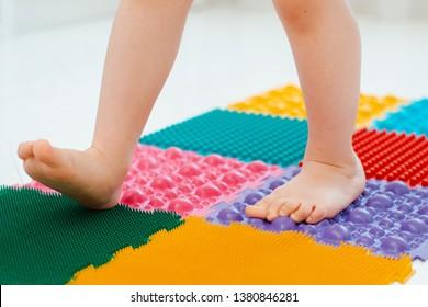 Toddler baby foot massage mat. Exercises for legs orthopedic massage carpet. prevention flat feet and hallux valgus Orthopedic massage puzzle floor mats for development children.