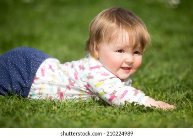 Toddler baby laying on the grass