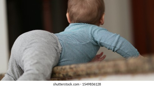 Toddler baby learning to climb step stair