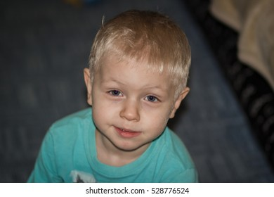 toddler with blond hair smiling